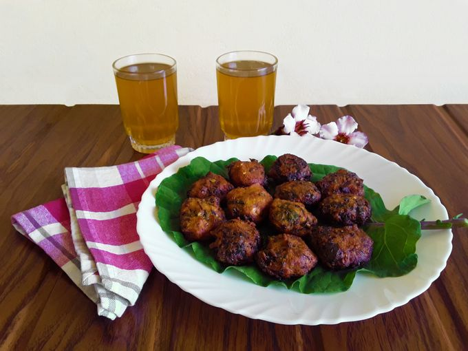 Spicy Collard Nuggets on a collard leaf with lime tea