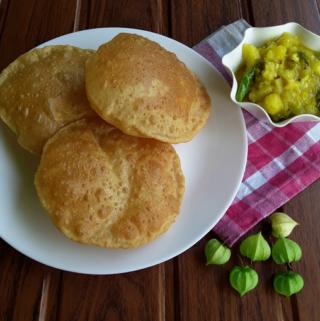 Puri / Poori - A simple, easy, healthy Indian, unleavened deep-fried wheat flatbread breakfast dish.