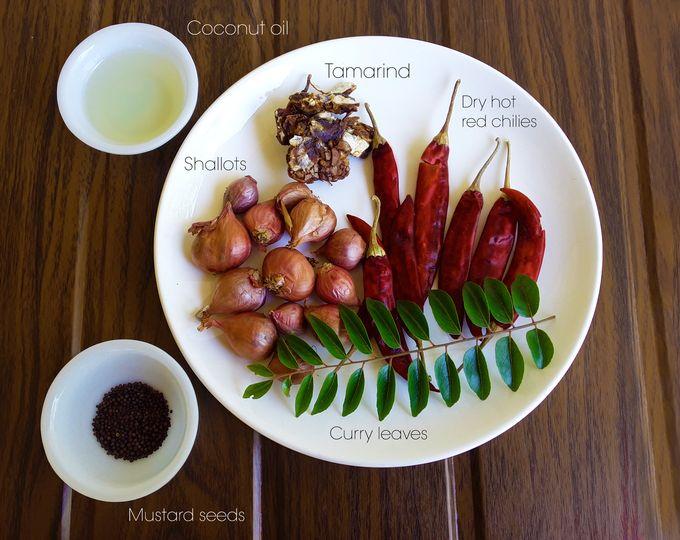 Ingredients for Shallot rasam / mulaku varutha puli / cheriyulli rasam - shallots, tamarind, coconut oil, dry hot red chilies, curry leaves, mustard seeds