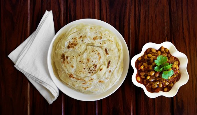 Avara Songe - A hot and savory, delicious, traditional Konkani lablab beans stir-fry - with porotta / paratha