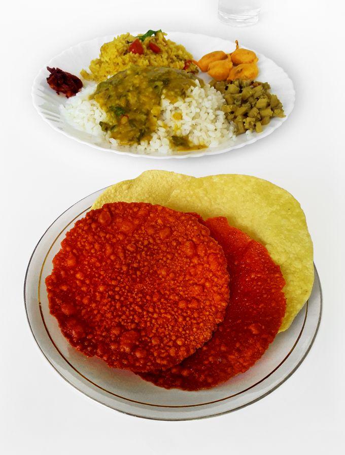 Chili papads and regular papads with rice.