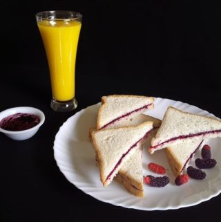 Scrumptious mulberry jam sandwiches with a refreshing glass of fresh country mango juice!